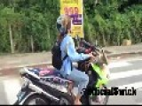Asian Woman Drives Scooter Without Crashing
