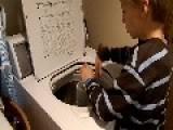 Autistic Boy Drumming On Washing Machine