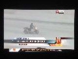 A Crazy Motorcyclist Riding On The Interstate In A Blizzard