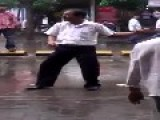 Bollywood Bliss: Middle Aged Man Dancing In The Middle Of The Busy Road In Mumbai