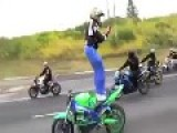 Biker Sets His Motorcycle On Cruise And Stands Backwards
