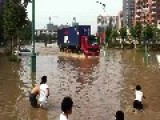 Beijing After Heavy Rain, Road Turn Out River, Kids Are Happy,2012. 7. 21