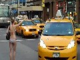 Chick On Bikini Hails A Taxi