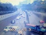 CCTV : Truck Looses Control And Smashes Into Many Cars And Through Central Barrier