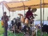 Drummer Drumming On Spring Trampoline Apparatus