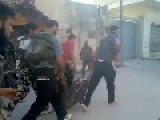 FSA Rebels Move An Wounded FSA Rebel Under SAA Fire