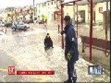 French TV Journalist Try Not To Laugh When People Fall On Icy Pavements