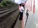 OUCH!!! Indian Man Falls Off The Train