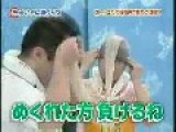 Two Japanese Men Play Tug Of War With Pantyhose