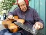 This Elderly Blind Turkish Lady Playing Guitar