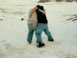 Two Eskimo Boys Slap Fighting And Wrestling In The Snow -
