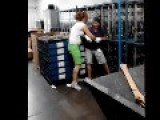 Warehouse Brawl - Redheaded Gal Tosses Him