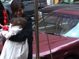 Katie Holmes Clutches Suri Tight To Protect Her From The Crowd