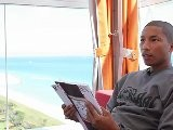 What Magazine Does Pharrell Williams Read In Miami During Art Basel?