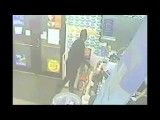 Stupid Criminal Can't Get His Mask On Security Camera