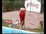 Model Falls Off Runway And Into Pool