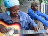 Beautiful African Plays Guitar In A Slightly Non-traditional Manner